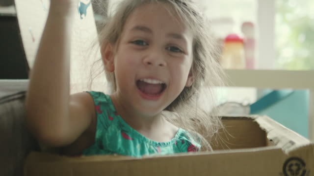 children playing with cardboard boxes. - hide and seek stock videos & royalty-free footage