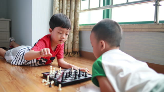 children playing with chess - strategy stock videos & royalty-free footage