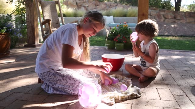 children playing with little water balloons - girls wearing see through clothes stock videos and b-roll footage