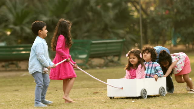 ms children playing with push cart in garden / delhi, india - push cart stock videos & royalty-free footage