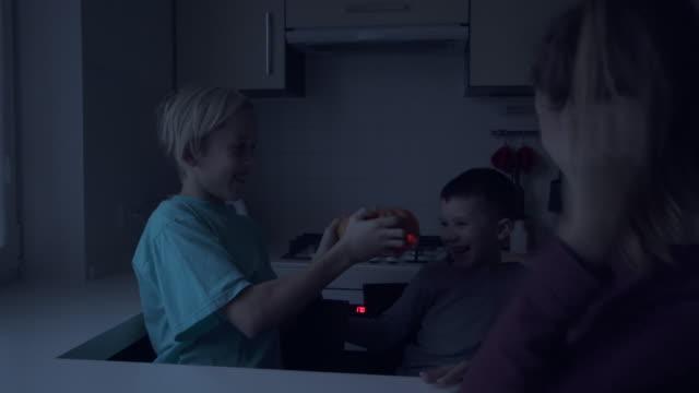 Children playing with scary halloween pumpkin jack-o-lantern