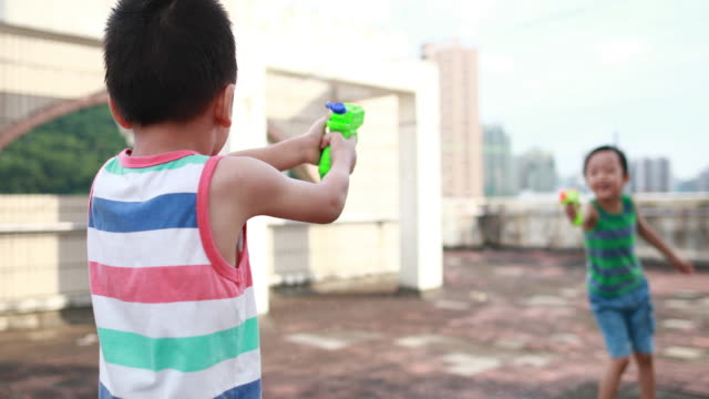 children playing with squirt gun - toy gun stock videos & royalty-free footage