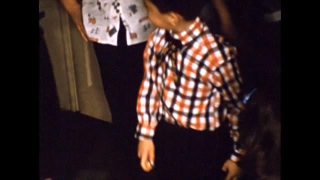 vídeos y material grabado en eventos de stock de 1957 children playing with top - table top view
