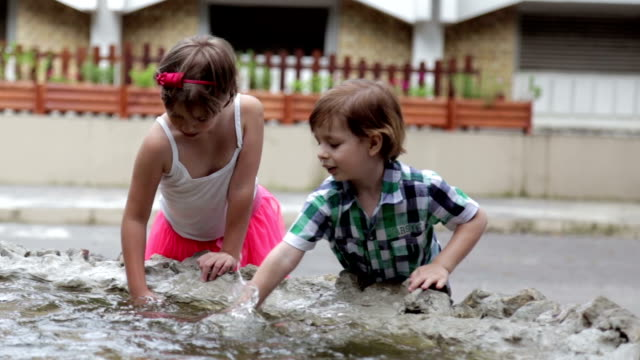 children playing with water in fountain - fountain stock videos & royalty-free footage