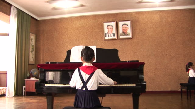 children practicing on the piano in north korea - practicing stock videos & royalty-free footage