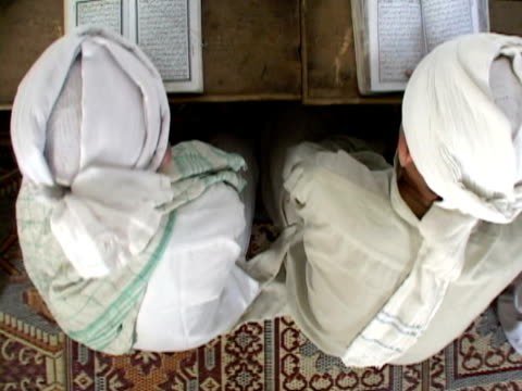 ms cs, children praying with koran, shitral valley, north west province, pakistan - koran stock videos and b-roll footage
