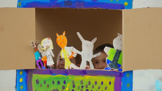 children presenting a puppet show with puppets they made themselves - pupazzo video stock e b–roll