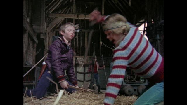 vídeos de stock e filmes b-roll de montage children pretending to be apaches in barn / united kingdom - dança da guerra