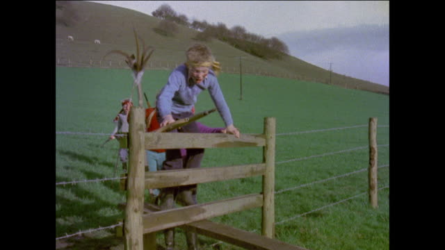 montage children pretending to be indians / children climbing over fence / children running toward neighborhood / united kingdom - 1977 stock videos & royalty-free footage