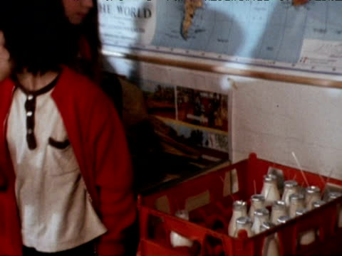 children queue for and drink milk in school classroom london 1971 - milk stock videos & royalty-free footage