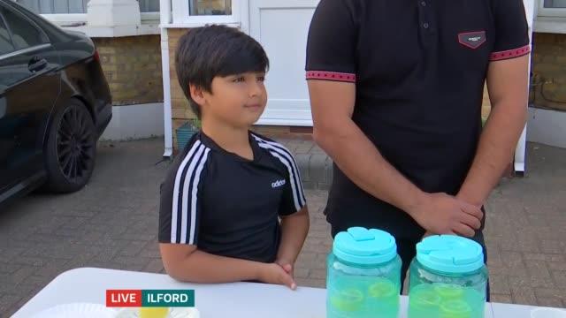 children raise money for yemen humanitarian crisis by selling 'lemonade for yemen aid'; england: london: ilford: ext shakil moosa, aayan moosa and... - ilford stock videos & royalty-free footage