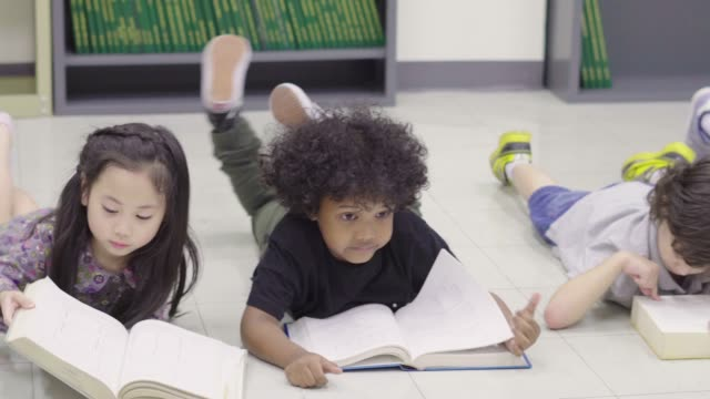 children read a books - elementary age stock videos & royalty-free footage