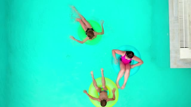 children relaxing in the pool - rubber ring stock videos & royalty-free footage