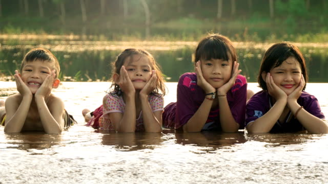children rest on chin in water