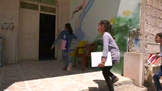 Children return to school at alTabqah childrens center on their first day back for the new semester in alTabqah Syria May 14 2018 Prior to the defeat...