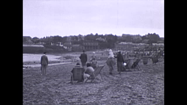 children ride on donkeys on the beach at the seaside town paignton. bathers come out of the sea. ice cream is being sold by dimeo's and pelosi's . a... - 1936 stock videos & royalty-free footage