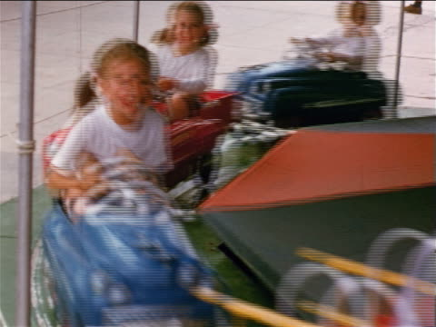 1951/52 HOME MOVIE children riding car merry-go-round at amusement park