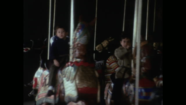 children riding on carousel horses in new york; 1971 - nostalgia stock videos & royalty-free footage