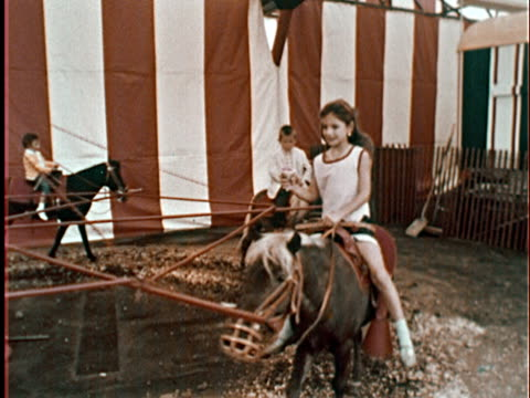 1965 ms children riding ponies in circles/ attendant holding onto young boy riding pony/ queens, ny - around the fair n.y stock videos & royalty-free footage