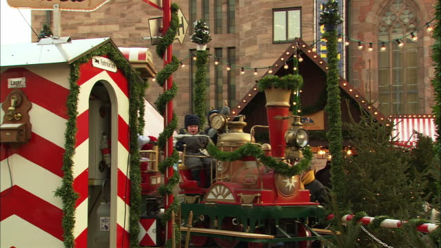WS Children riding train ride at Christmas Market (Kinderweihnacht) / Nuremberg, Bavaria, Germany