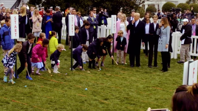 children roll eggs during the 140th annual easter egg roll on the south lawn of the white house april 2 2018 in washington dc the white house said... - vanessa haydon stock-videos und b-roll-filmmaterial