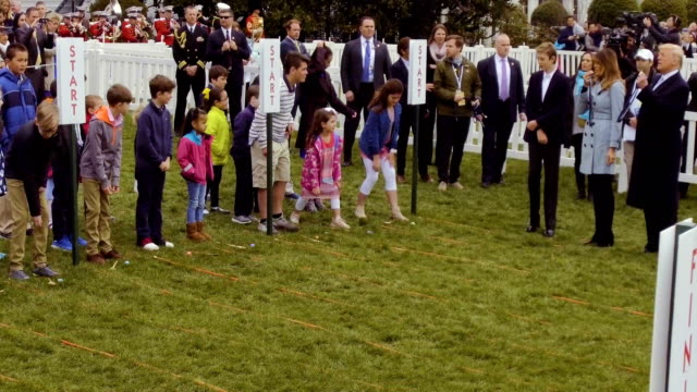 children roll eggs during the 140th annual easter egg roll on the south lawn of the white house april 2 2018 in washington dc the white house said... - b rolle stock-videos und b-roll-filmmaterial
