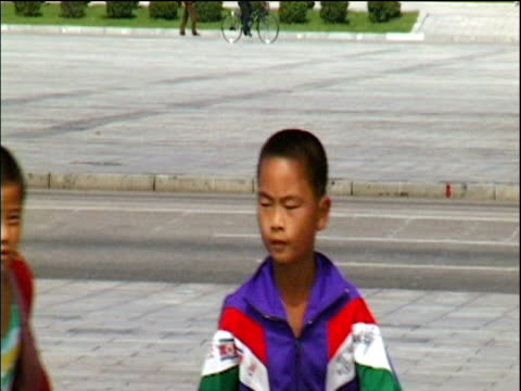 Children rollerblading in large public square Pyongyang