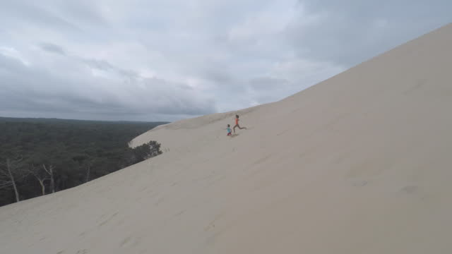 children run on the pyla dune - dune of pilat stock videos and b-roll footage