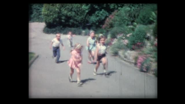 1962 children run race in garden, one gets left behind - failure stock videos & royalty-free footage
