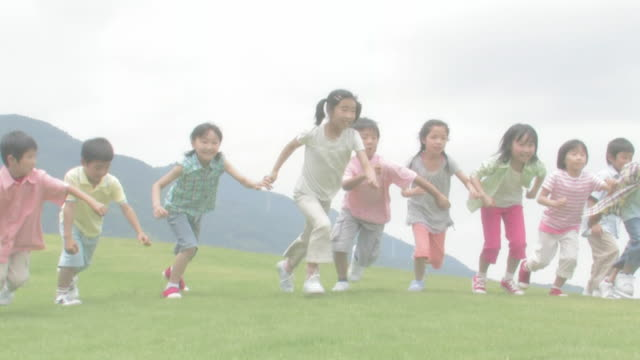 Children running a race on green