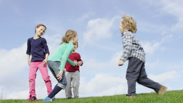 Children running and playing tag outdoors