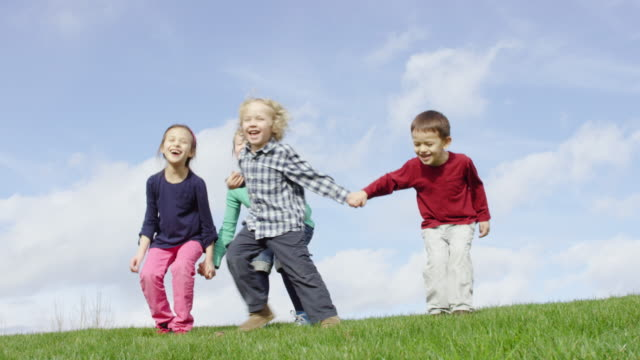 children running and playing tag outdoors - tag 7 stock videos & royalty-free footage