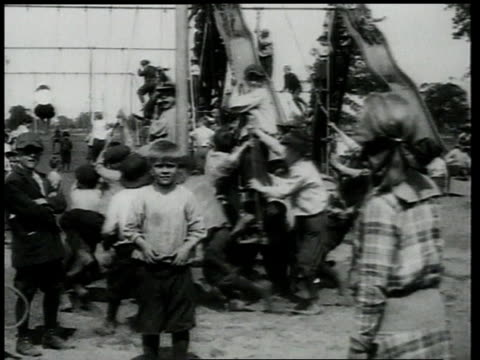 1918 ws children running around playground and going down slides in streams / brooklyn, new york, united states - 1918 stock videos & royalty-free footage