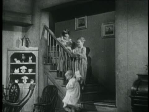 B/W 1946 children running down stairs to stockings on Christmas day