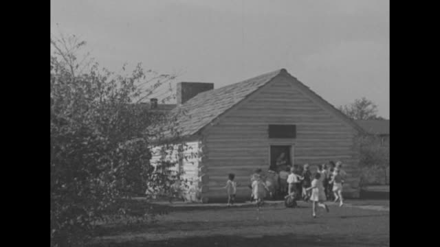 children running from marthamary chapel on grounds of greenfield village / open book / mcguffey school with teacher ringing bell and children running... - school bell stock videos and b-roll footage
