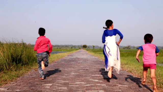 children running on country road. - horizon stock videos & royalty-free footage