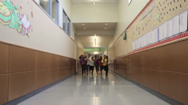 WS Children (8-11) running through corridor of elementary school / University Place, Washington, USA