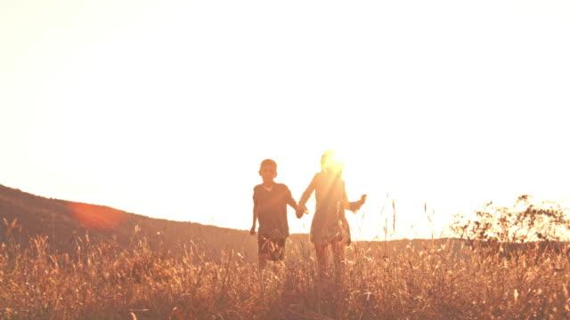 Children running together outdoors