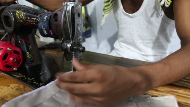 children seen inside bangladesh's garments workshop in dhaka children as young as nine have been found working shift up to 18 hours long inside... - arbeitsintensive produktion stock-videos und b-roll-filmmaterial