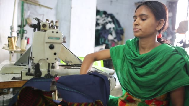 children seen inside bangladesh's garments workshop in dhaka children as young as nine have been found working shift up to 18 hours long inside... - slavery stock videos and b-roll footage
