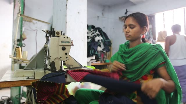 children seen inside bangladesh's garments workshop in dhaka. children as young as nine have been found working shift up to 18 hours long inside... - employment and labor stock videos & royalty-free footage