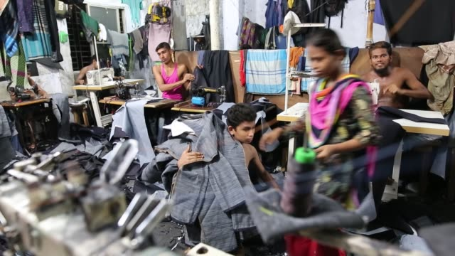 stockvideo's en b-roll-footage met children seen inside bangladesh's garments workshop in dhaka children as young as nine have been found working shift up to 18 hours long inside... - kledingstuk