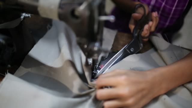 children seen inside bangladesh's garments workshop in dhaka children as young as nine have been found working shift up to 18 hours long inside... - kleidungsstück stock-videos und b-roll-filmmaterial