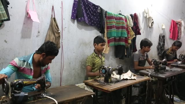 Children seen inside Bangladesh's garments workshop in Dhaka Children as young as nine have been found working shift up to 18 hours long inside...