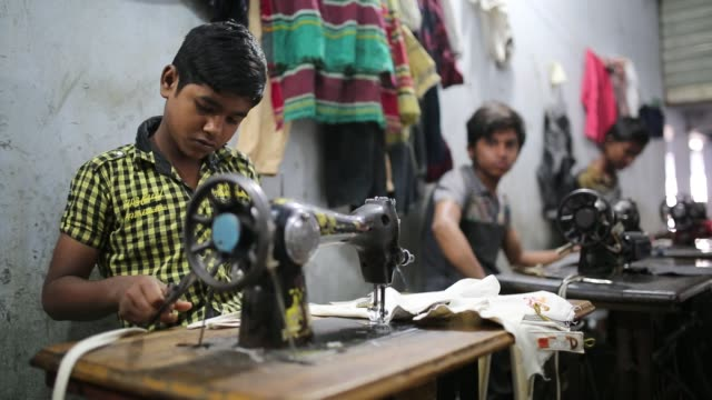 children seen inside bangladesh's garments workshop in dhaka children as young as nine have been found working shift up to 18 hours long inside... - employment issues stock videos & royalty-free footage