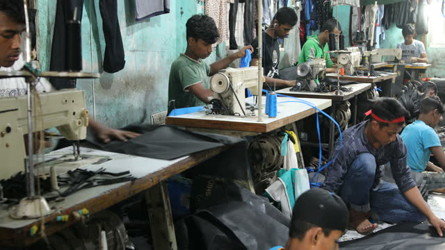children seen inside bangladesh's garments workshop in dhaka, bangladesh on january 29, 2020. children as young as nine have been found working... - textile stock videos & royalty-free footage