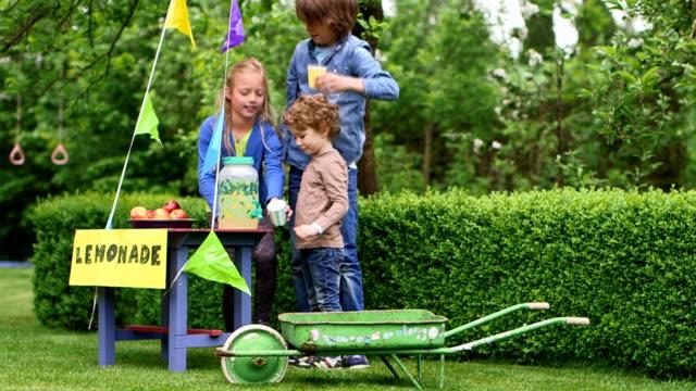 Children selling lemonade in Garden