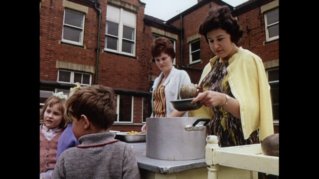 MONTAGE Children served lunch outdoors at school for the deaf in United Kingdom