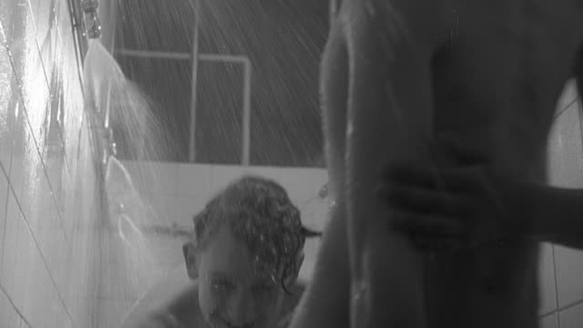 1960 b/w children showering and drying off / united kingdom - spind stock-videos und b-roll-filmmaterial