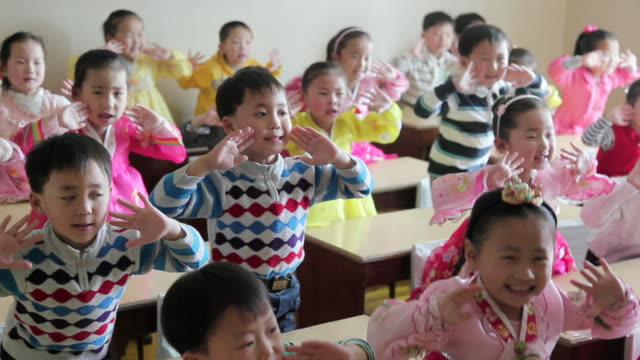 children sing in a classroom in pyongyang, north korea. - north korea stock videos & royalty-free footage